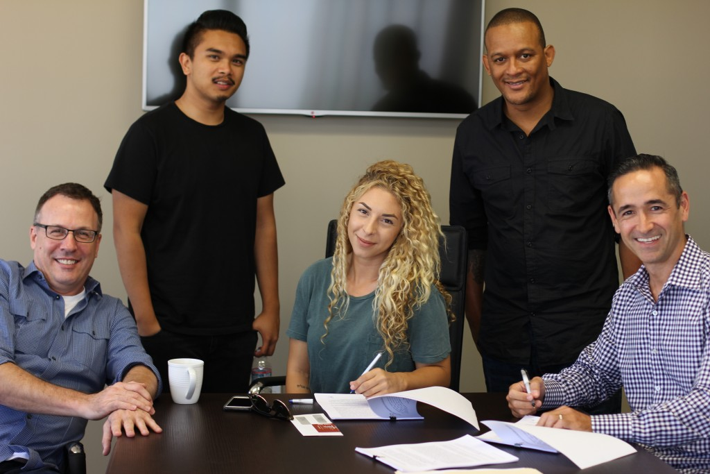 Songwriter Allison Kaplan signs with Angry Mob (l to r, Sean Harrison, Ralph Torrefranca, Allison Kaplan, Jay Sloan, Marc Caruso)